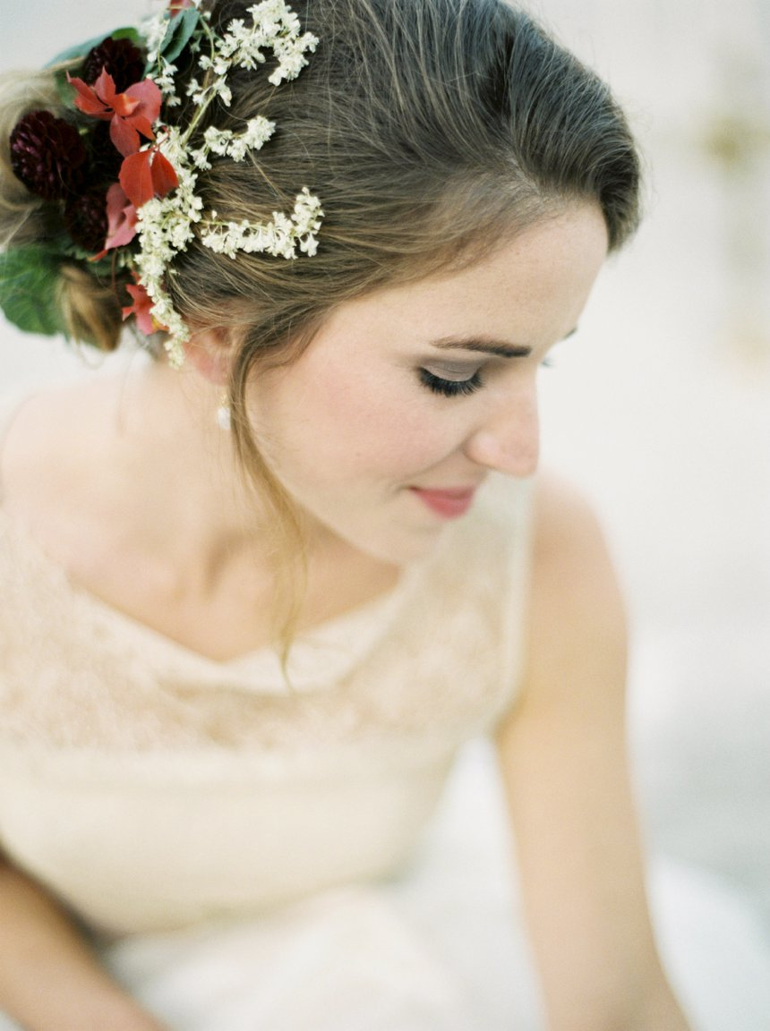 Bridal portrait with autumnal floral hairstyle