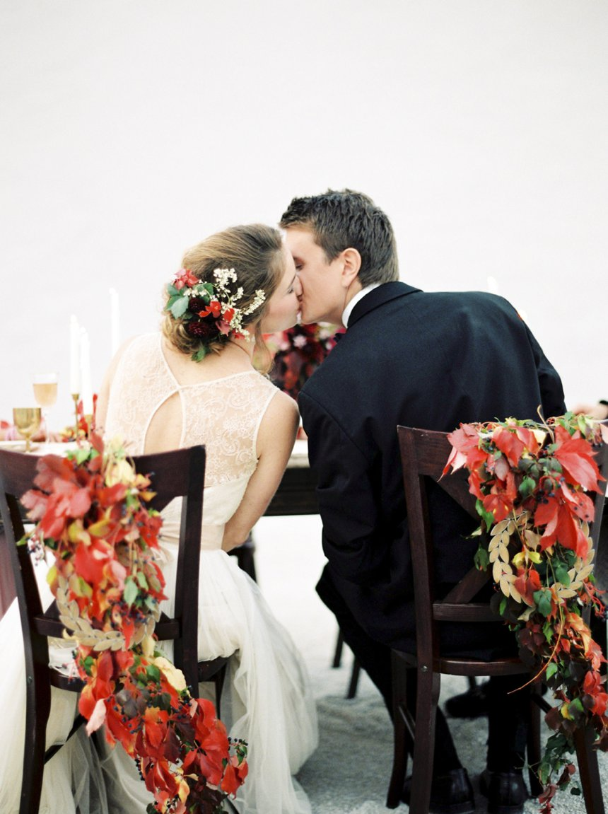 Sweet couple is kissing at the reception. Autumn Wedding